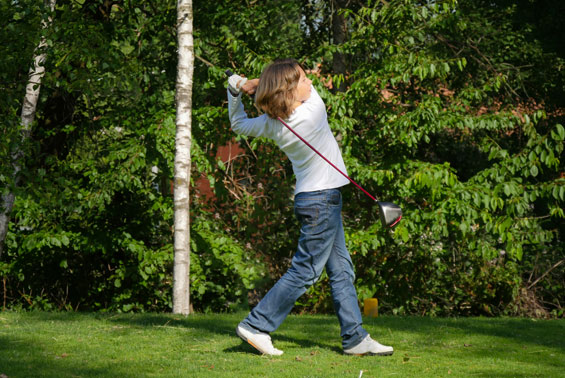 Young-golfer-kid-teeing-off-kids-playing-golf